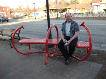 Bench sculpture, with some goofy-looking bloke for scale.