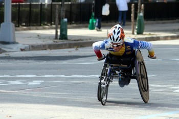 a wheelchair marathoner, mid-push